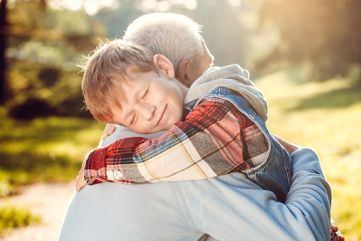 Grandfather hugging his grandson